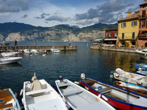 Colourful fishing boats in Malcesine harbour. Lake Garda, Italy Royalty Free Stock Images