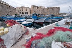 Colourful fishing nets in the harbour in Gallipoli, Puglia Italy. Plastic fishing nets can be polluting and a danger to sea life. Gallipoli Italy. Photograph of royalty free stock photos
