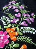 Colourful flower and green leaves  hand embroidery Royalty Free Stock Photography