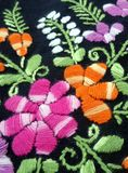 Colourful flower and green leaves  hand embroidery Stock Photos