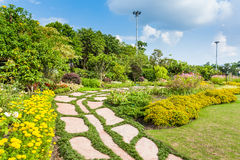 Colourful Flowerbeds and Winding Grass Pathway Royalty Free Stock Photography