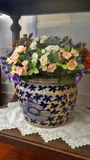 Colourful flowers in antique blue and white vase Royalty Free Stock Photo