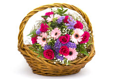 Colourful flowers in a basket Stock Images
