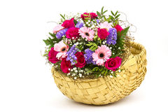 Colourful flowers in a basket Stock Photo