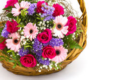 Colourful flowers in a basket Stock Photos