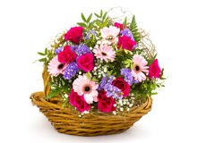 Colourful flowers in a basket Royalty Free Stock Photo
