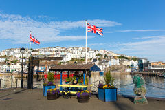 Colourful flowers and union jack flags Brixham harbour Devon Stock Images