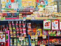 Colourful food items on display at small conveience store Stock Images