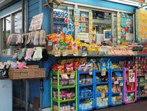 Colourful food items outside a small convenience store Stock Images