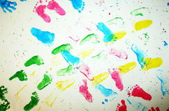 Kids foot prints. Colourful foot prints on white copy space stock photo