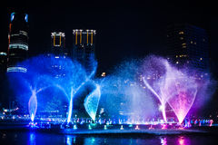 Colourful fountain Stock Images