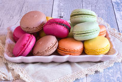 Colourful french macaroons on plate Stock Photography
