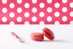 Colourful french macaroons on polka dot background Stock Photo
