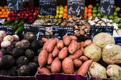 Colourful fresh fruit and vegetables on display in street market Stock Image