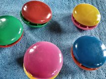 Colourful fridge magnets. Closeup view of multicoloured fridge magnets Stock Photos