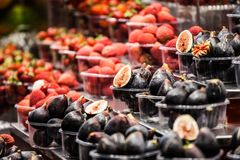 Colourful fruit and figs at market stall in Boqueria market in Barcelona. Stock Image
