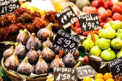 Colourful fruit and figs at market stall in Boqueria market in Barcelona. Royalty Free Stock Photography