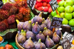 Colourful fruit and figs at market stall in Boqueria market in Barcelona. Stock Photo