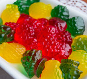 Colourful fruit jelly candie. S on a white plate stock photo