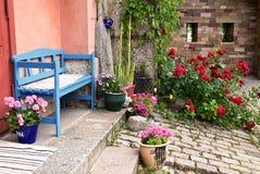 Colourful garden. Beautifully decorated garden in summer Stock Photos