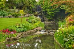 Colourful garden waterfall stream Royalty Free Stock Image