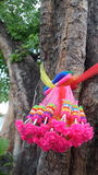 Colourful garland and clothes tied round the big Po Tree Royalty Free Stock Image