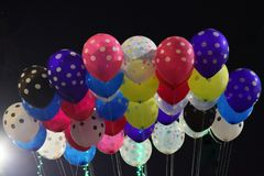 Colourful balloons flutterng in the air royalty free stock photography