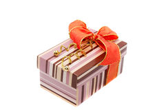 Colourful gift box with orange bow Stock Images