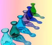 colourful glass vases and reflections Royalty Free Stock Photo