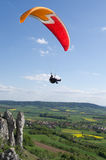 Colourful glider over the valley Stock Photography