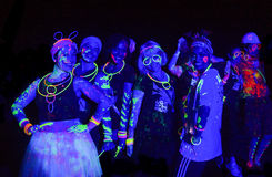 Colourful Glow Run girls of Africa. Neon paint splashed girls of South Africa at the 2014 Glow Run Port Elizabeth Royalty Free Stock Photography