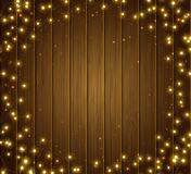 Colourful glowing Christmas garland, wood texture. Lights effects. Greeting card Royalty Free Stock Photos