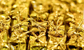 Colourful gold gift shaped confetti Royalty Free Stock Photography