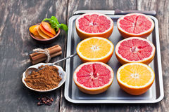 Colourful  grapefruit halves  ready for baking with brown sugar Stock Image