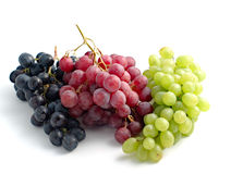 Colourful grapes. Three branches of grape in different colours Royalty Free Stock Photography