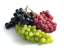 Colourful grapes. Three branches of grape in different colours Royalty Free Stock Photos