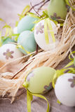 Colourful green Easter eggs in straw Stock Photo