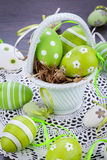 Colourful green Easter eggs in straw Royalty Free Stock Image