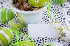 Colourful green Easter eggs in straw Stock Photography
