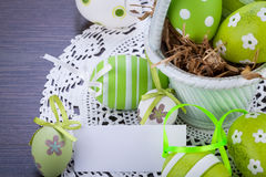 Colourful green Easter eggs in straw Royalty Free Stock Photos