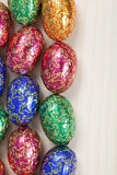 Colourful group of easter eggs. A colourful group of easter eggs all facing upward and all on the left side of the photo Royalty Free Stock Photos