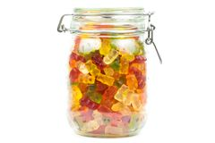Colourful gummy bears / jelly baby candy sweets in a jar royalty free stock images