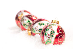 Colourful hand painted  glass baubles in a line Stock Photo