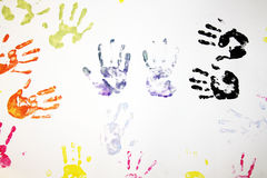 Kids hand prints. Colourful hand prints on white copy space stock photos