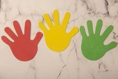 Colourful hand prints on white marble background. Colourful hand prints on white background stock photos