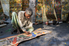 Colourful handicraft paintings are being prepared for sale in Pingla village. PINGLA, WEST BENGAL , INDIA - NOVEMBER 16TH 2014 : Colourful paintings are being Stock Photo
