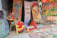 Colourful handicrafts are being prepared for sale in Pingla village by Indian rural woman worker. Royalty Free Stock Photos