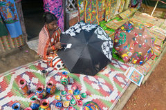 Colourful handicrafts are being prepared for sale in Pingla village by Indian rural woman worker. Stock Images