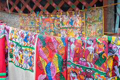 Colourful handicrafts are being prepared for sale in Pingla village. Stock Photos