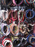 Colourful Handmade Bracelets. Rows of handmade bracelets for sale in Chinatown, Singapore royalty free stock images